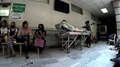 Patient on stretcher attended by relative - stock footage