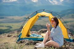 Beautiful girl drinks tea outdoors Stock Photos