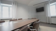 Conference Room. Interior shot of an emtpy conference room. Slider dolly track. Stock Footage