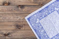 Blue cloth on wooden table, top view - stock photo