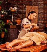 Man having Ayurvedic spa treatment. - stock photo