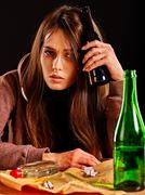 Girl in depression drink alcohol. Drinking habits. Stock Photos
