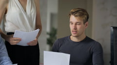Young man is offering business decision to female boss standing nearby - stock footage