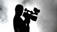 Camera Operator / Silhouette in the smoke Stock Footage