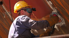 Workers polishing and welding during reparation of ship in shipyard Stock Footage