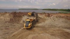 RUSSIA ST.PETERBURG Excavator digging ground and load truck Stock Footage