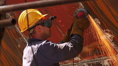 Shipyard Workers repairing and painting new layer of paint on modern ship Stock Footage