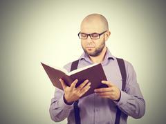 man caucasian professor reading book - stock photo