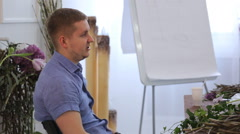 Professional designer holds seminar in art studio in day time Stock Footage
