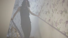 Young woman dancing at the stairwell Stock Footage