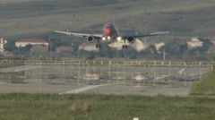 Airplane  landing on runway front distant view - vapor super tele Stock Footage
