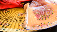 Set of traditional hand fans decorated with flowers gyrating Stock Footage