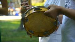 Capoeiristas play musical instruments pandeiro (tambourine) and the berimbau Stock Footage