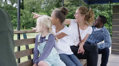 4K Families visiting rural activity centre looking out at sights on tractor ride Stock Footage