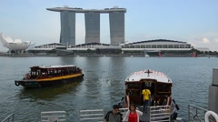 Ferry boat and Skyline in Downtown Core at Marina Bay Financial Center in Singap Stock Footage