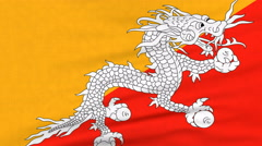 National flag of Bhutan flying on the wind Stock Footage