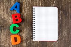 ABCD spelling  and blank notebook Stock Photos