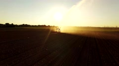 AERIAL: Industrial irrigation of a salad field with a sunset Stock Footage