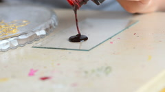 Red paint is pouring from a paint jar Stock Footage