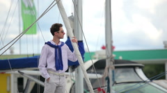 The guy waiting near the yachts Stock Footage