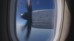 Turboprop propellor engine viewed through window of plane. Stock Footage