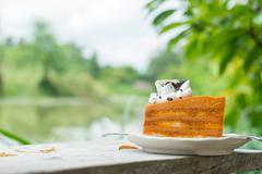 Thai Tea Cake  on wooden desk Stock Photos