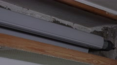 Roller shutter in a opened roller shutter casing Stock Footage