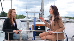 Two girls are talking on the yacht Stock Footage