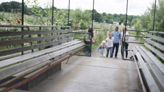 4K Family visiting rural activity centre take their seats for a tractor ride Stock Footage