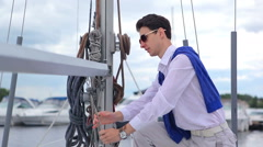 Man pulls a rope reels off a yacht Stock Footage