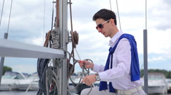 Man reeling the rope on the yacht Stock Footage