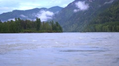 On the shore of a mountain river Stock Footage