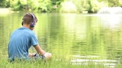 Teen boy at lakeside Stock Footage