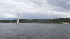 Blue yacht floating in the river Stock Footage