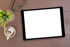 Black tablet white screen on table top view Stock Photos