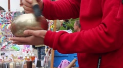 Man is Playing with the Stick on the Hindi Bowl at the Festival Stock Footage