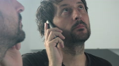 Mobile phone conversation in front of the mirror Stock Footage