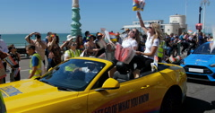 Two young caucasian girls celebrate at Brighton gay pride parade Stock Footage