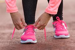 Sport woman tying shoe laces Stock Photos