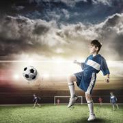 Young football champion - stock photo