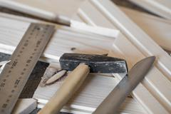 Hammer, knife, ruler and tongue and groove boards on working place Stock Photos