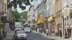 Tourists and restaurants on Rue Saint Louis in Quebec City, Canada. Stock Footage