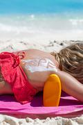 Healthy suntanning with SPF bodycare Stock Photos