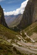 Serpentine Road for Crossing Andes Mountains between Peru and Bolivia Stock Photos