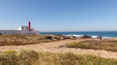 Lighthouse on a cliff near Atlantic Ocean, Sintra, Portugal aerial view Stock Footage