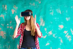 Young woman getting experience using VR-headset glasses of virtual reality much Stock Photos