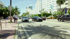 Miami beach, cars passing on Collins Ave Stock Footage