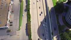 Fly And Hover Over Busy Highway And Office Buildings With Downtown View Stock Footage