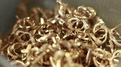 Perform a cut on a gold ring Stock Footage