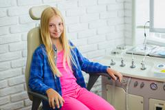 Smiling girl in Otolaryngologist cabinet at clinic Stock Photos
